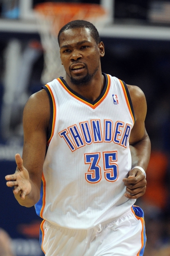 Apr 16, 2014; Oklahoma City, OK, USA;  Oklahoma City Thunder forward Kevin Durant (35) reacts after a made basket against the Detroit Pistons at Chesapeake Energy Arena. Mandatory Credit: Mark D. Smith-USA TODAY Sports
