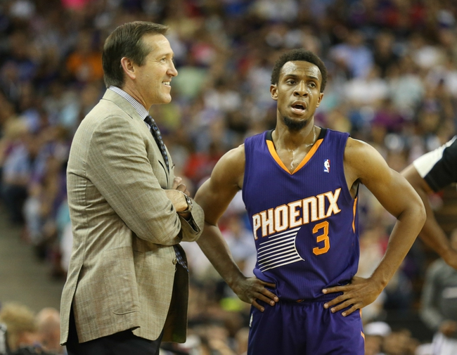 Apr 16, 2014; Sacramento, CA, USA; Phoenix Suns guard Ish Smith (3) speaks with head coach Jeff Hornacek between plays against the Sacramento Kings during the second quarter at Sleep Train Arena. Mandatory Credit: Kelley L Cox-USA TODAY Sports