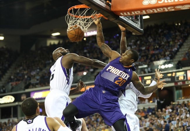 Apr 16, 2014; Sacramento, CA, USA; Phoenix Suns guard Archie Goodwin (20) dunks the ball between Sacramento Kings forward Quincy Acy (5) and Sacramento Kings guard Ben McLemore (16) during the second quarter at Sleep Train Arena. Mandatory Credit: Kelley L Cox-USA TODAY Sports