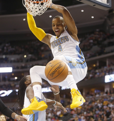Apr 16, 2014; Denver, CO, USA; Denver Nuggets guard Randy Foye (4) dunks the ball during the second quarter against the Golden State Warriors at Pepsi Center. Mandatory Credit: Chris Humphreys-USA TODAY Sports