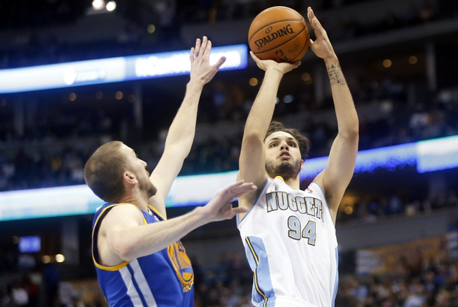 Apr 16, 2014; Denver, CO, USA; Denver Nuggets guard Evan Fournier (94) shoots the ball during the second quarter against the Golden State Warriors at Pepsi Center. Mandatory Credit: Chris Humphreys-USA TODAY Sports