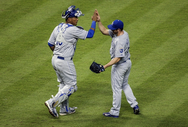 Apr 16, 2014; Houston, TX, USA; Kansas City Royals relief pitcher Greg Holland (56) and catcher Salvador Perez (13) celebrate after defeating the Houston Astros 6-4 at Minute Maid Park. Mandatory Credit: Troy Taormina-USA TODAY Sports