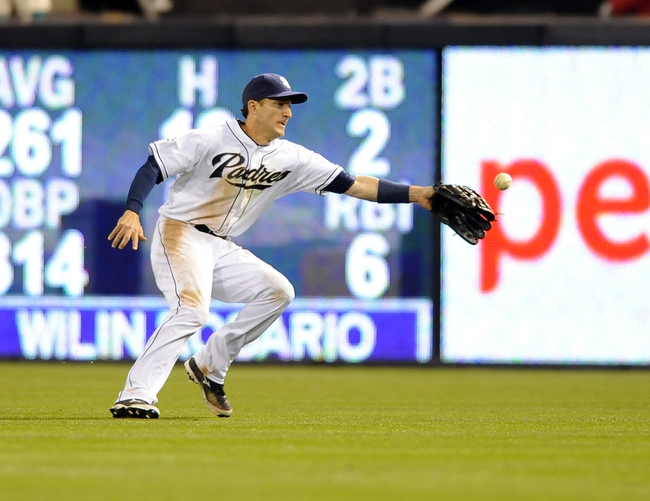 Apr 16, 2014; San Diego, CA, USA; San Diego Padres right fielder Chris Denorfia (13) is unable to catch a ball during the ninth inning against the Colorado Rockies at Petco Park. Mandatory Credit: Christopher Hanewinckel-USA TODAY Sports