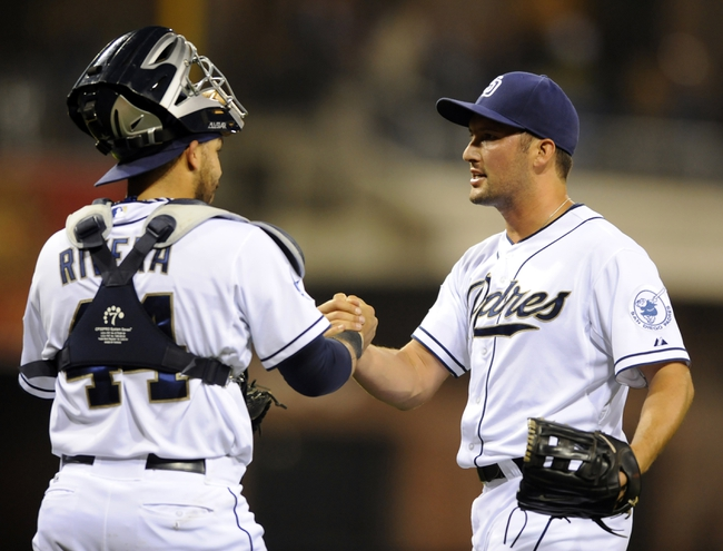 Apr 16, 2014; San Diego, CA, USA; San Diego Padres relief pitcher Huston Street (16) celebrates with catcher Rene Rivera (44) after a win against the Colorado Rockies at Petco Park. The Padres won 4-2. Mandatory Credit: Christopher Hanewinckel-USA TODAY Sports