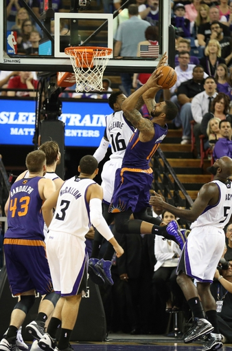 Apr 16, 2014; Sacramento, CA, USA; Phoenix Suns forward Markieff Morris (11) goes up for a basket against Sacramento Kings guard Ben McLemore (16) during the fourth quarter at Sleep Train Arena. The Phoenix Suns defeated the Sacramento Kings 104-99. Mandatory Credit: Kelley L Cox-USA TODAY Sports