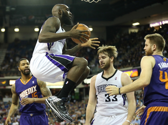Apr 16, 2014; Sacramento, CA, USA; Sacramento Kings forward Quincy Acy (5) gathers the ball above Phoenix Suns forward Marcus Morris (15), Sacramento Kings center Aaron Gray (33) and Phoenix Suns forward Shavlik Randolph (43) during the fourth quarter at Sleep Train Arena. The Phoenix Suns defeated the Sacramento Kings 104-99. Mandatory Credit: Kelley L Cox-USA TODAY Sports