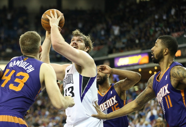 Apr 16, 2014; Sacramento, CA, USA; Sacramento Kings center Aaron Gray (33) drives to the basket between Phoenix Suns forward Shavlik Randolph (43), forward Marcus Morris (15) and forward Markieff Morris (11) during the fourth quarter at Sleep Train Arena. The Phoenix Suns defeated the Sacramento Kings 104-99. Mandatory Credit: Kelley L Cox-USA TODAY Sports