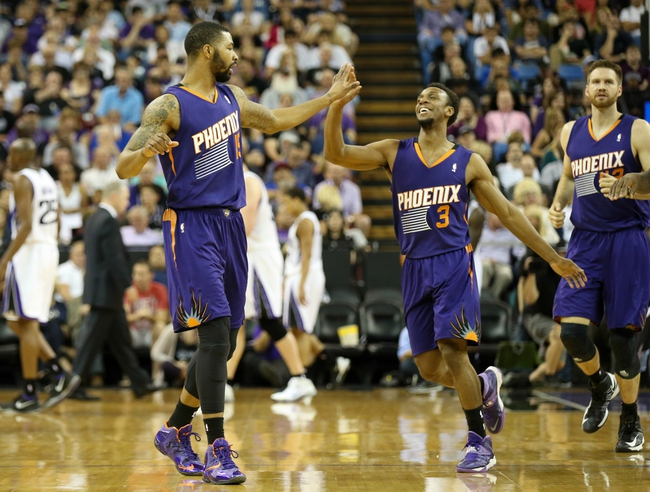 Apr 16, 2014; Sacramento, CA, USA; Phoenix Suns guard Ish Smith (3) high fives forward Marcus Morris (15) as a timeout is called against the Sacramento Kings during the fourth quarter at Sleep Train Arena. The Phoenix Suns defeated the Sacramento Kings 104-99. Mandatory Credit: Kelley L Cox-USA TODAY Sports