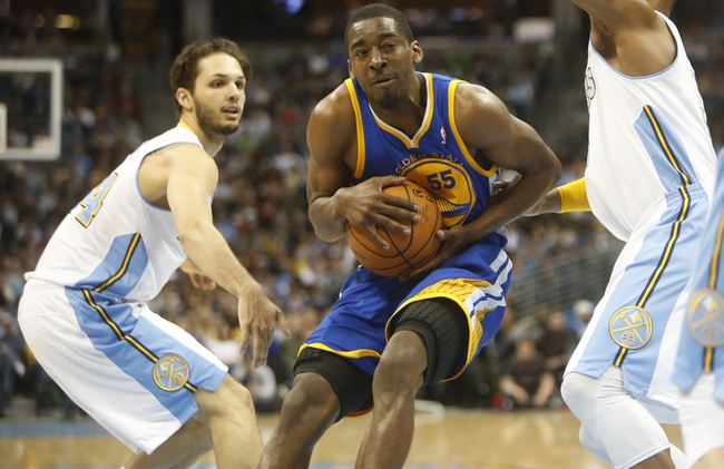 Apr 16, 2014; Denver, CO, USA; Golden State Warriors guard Jordan Crawford (55) drives to the basket during the second half against the Denver Nuggets at Pepsi Center.  The Warriors won 116-112.  Mandatory Credit: Chris Humphreys-USA TODAY Sports