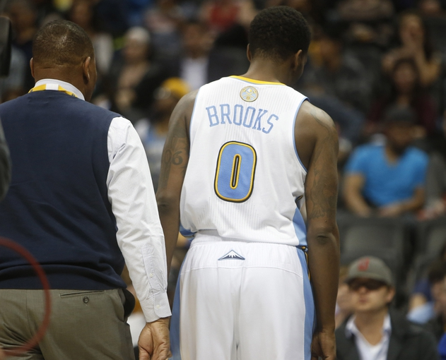 Apr 16, 2014; Denver, CO, USA; Denver Nuggets guard Aaron Brooks (0) walks off the court after being ejected during the second half against the Golden State Warriors at Pepsi Center.  The Warriors won 116-112.  Mandatory Credit: Chris Humphreys-USA TODAY Sports
