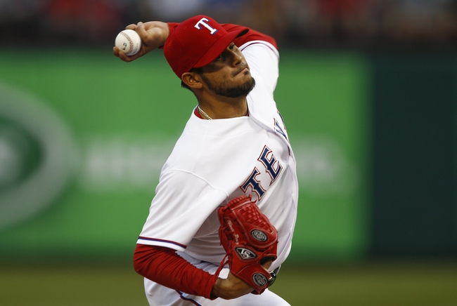 Apr 18, 2014; Arlington, TX, USA; Texas Rangers starting pitcher Martin Perez (33) throws the ball against the Chicago White Sox during the first inning at Rangers Ballpark in Arlington. Mandatory Credit: Jim Cowsert-USA TODAY Sports