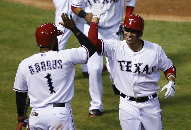 Apr 18, 2014; Arlington, TX, USA; Texas Rangers catcher Robinson Chirinos (61) celebrates with shortstop Elvis Andrus (1) after hitting a two run homer against the Chicago White Sox during the third inning of a baseball game at Rangers Ballpark in Arlington. Mandatory Credit: Jim Cowsert-USA TODAY Sports