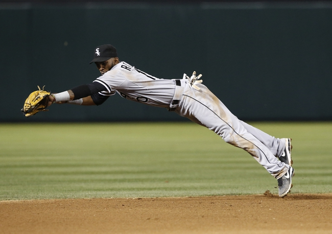 Apr 18, 2014; Arlington, TX, USA; Chicago White Sox shortstop Alexei Ramirez (10) dives and catches the ground out hit by Texas Rangers third baseman Kevin Kouzmanoff (no pictured) during the sixth inning of a baseball game at Rangers Ballpark in Arlington. Mandatory Credit: Jim Cowsert-USA TODAY Sports