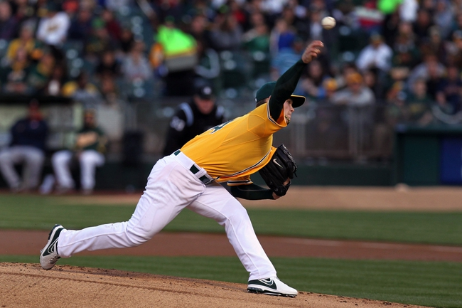 Apr 18, 2014; Oakland, CA, USA; Oakland Athletics starting pitcher Sonny Gray (54) throws to the Houston Astros in the first inning of their baseball game at O.co Coliseum. Mandatory Credit: Lance Iversen-USA TODAY Sports