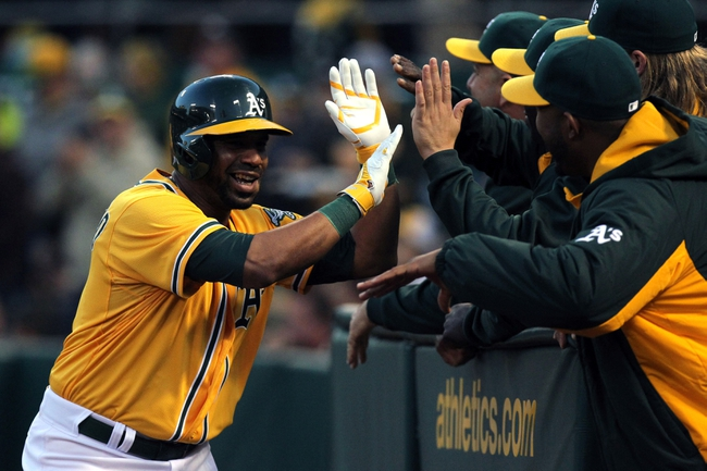 Apr 18, 2014; Oakland, CA, USA; Oakland Athletics Alberto Callaspo (18) is greeted at the dugout after hitting a three run home run against the Houston Astros in the first inning of their baseball game at O.co Coliseum. Mandatory Credit: Lance Iversen-USA TODAY Sports