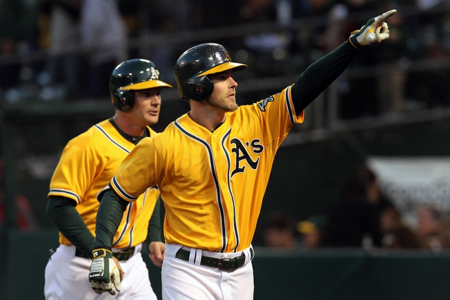 Apr 18, 2014; Oakland, CA, USA; Oakland Athletics L to R catcher John Jaso (5) celebrates right fielder Josh Reddick (16) two run home run against the Houston Astros in the first inning of their baseball game at O.co Coliseum. Mandatory Credit: Lance Iversen-USA TODAY Sports