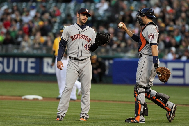 Apr 18, 2014; Oakland, CA, USA; Houston Astros starting pitcher Jarred Cosart (48) talks with this catcher Jason Castro (15) in the first inning of their baseball game with the Oakland Athletics at O.co Coliseum. Mandatory Credit: Lance Iversen-USA TODAY Sports
