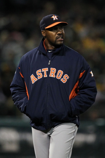 Apr 18, 2014; Oakland, CA, USA; Houston Astros manager Bo Porter walks on the field in the seventh inning of their baseball game with the Oakland Athletics at O.co Coliseum. The Astros won 11-3. Mandatory Credit: Lance Iversen-USA TODAY Sports.