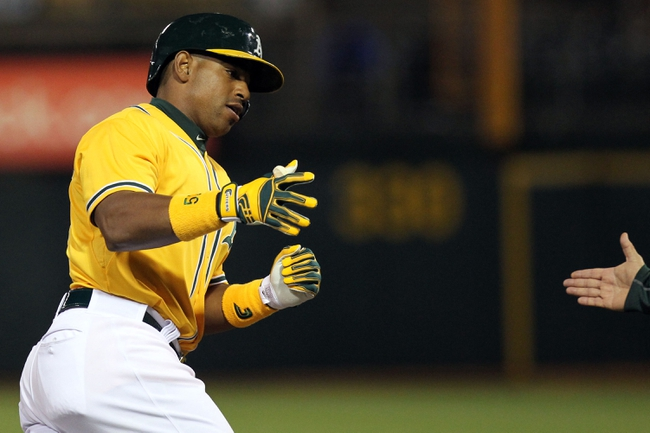 Apr 18, 2014; Oakland, CA, USA; Oakland Athletics Yoenis Cespedes (52) rounds third base after hitting a home run against the Houston Astros at O.co Coliseum. Mandatory Credit: Lance Iversen-USA TODAY Sports