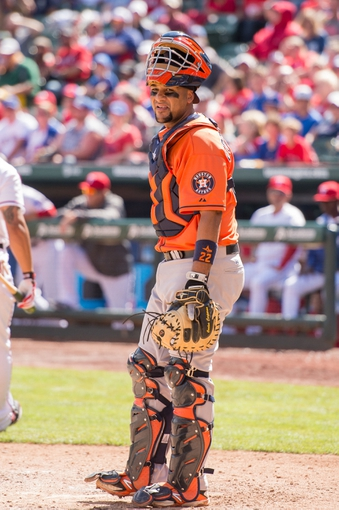 Apr 13, 2014; Arlington, TX, USA; Houston Astros catcher Carlos Corporan (22) during the game against the Texas Rangers at Globe Life Park in Arlington. The Rangers defeated the Astros 1-0. Mandatory Credit: Jerome Miron-USA TODAY Sports