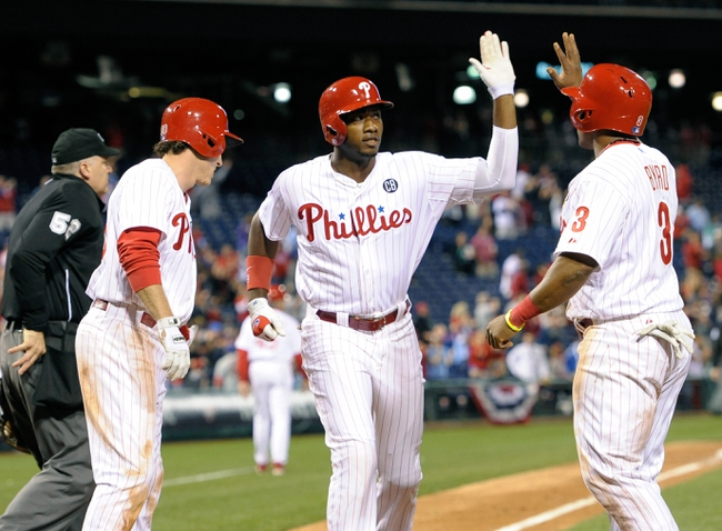 Apr 14, 2014; Philadelphia, PA, USA; Philadelphia Phillies left fielder Domonic Brown (9) celebrates his three run home run with second baseman Chase Utley (26) and right fielder Marlon Byrd (3) against the Atlanta Braves at Citizens Bank Park. The Braves defeated the Phillies, 9-6. Mandatory Credit: Eric Hartline-USA TODAY Sports