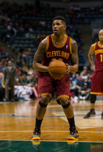 Apr 11, 2014; Milwaukee, WI, USA; Cleveland Cavaliers forward Alonzo Gee (33) shoots a free throw during the game against the Milwaukee Bucks at BMO Harris Bradley Center.  Milwaukee won 119-116.  Mandatory Credit: Jeff Hanisch-USA TODAY Sports
