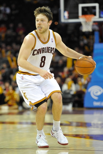 Apr 9, 2014; Cleveland, OH, USA; Cleveland Cavaliers guard Matthew Dellavedova (8) dribbles against the Detroit Pistons at Quicken Loans Arena. Cleveland won 122-100. Mandatory Credit: David Richard-USA TODAY Sports