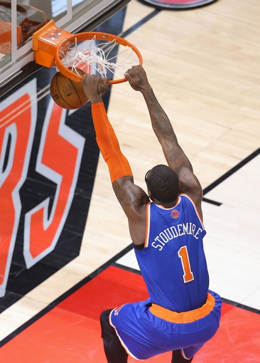 Apr 11, 2014; Toronto, Ontario, CAN; New York Knicks forward Amar'e Stoudemire (1) dunks against the Toronto Raptors at Air Canada Centre. The Knicks beat the Raptors 108-100. Mandatory Credit: Tom Szczerbowski-USA TODAY Sports