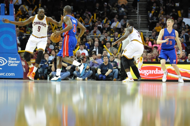 Apr 9, 2014; Cleveland, OH, USA; Cleveland Cavaliers forward Luol Deng (9) defends Detroit Pistons guard Rodney Stuckey (3) at Quicken Loans Arena. Cleveland won 122-100. Mandatory Credit: David Richard-USA TODAY Sports