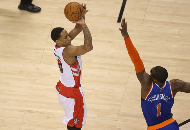 Apr 11, 2014; Toronto, Ontario, CAN; Toronto Raptors guard DeMar DeRozan (10) hits a three-pointer against the defense of New York Knicks forward Amar'e Stoudemire (1) at Air Canada Centre. The Knicks beat the Raptors 108-100. Mandatory Credit: Tom Szczerbowski-USA TODAY Sports