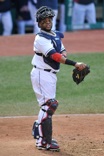 Apr 9, 2014; Cleveland, OH, USA; Cleveland Indians catcher Carlos Santana (41) reacts against the San Diego Padres in game two at Progressive Field. San Diego won 2-1. Mandatory Credit: David Richard-USA TODAY Sports