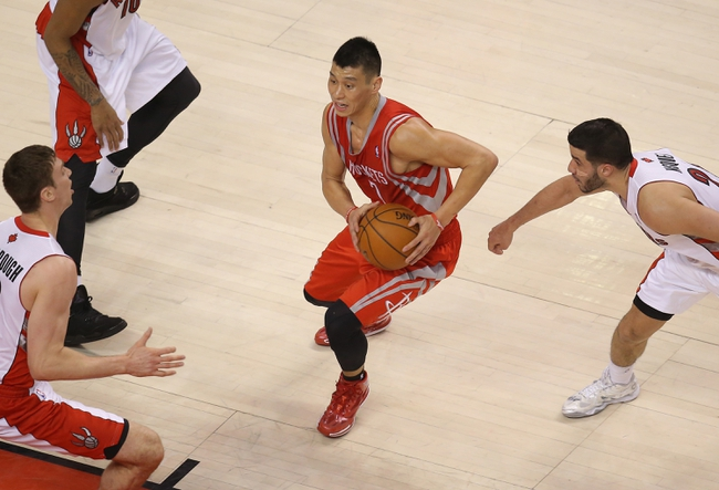 Apr 2, 2014; Toronto, Ontario, CAN; Houston Rockets guard Jeremy Lin (7) goes to the basket against the Toronto Raptors at Air Canada Centre. The Raptors beat the Rockets 107-103. Mandatory Credit: Tom Szczerbowski-USA TODAY Sports