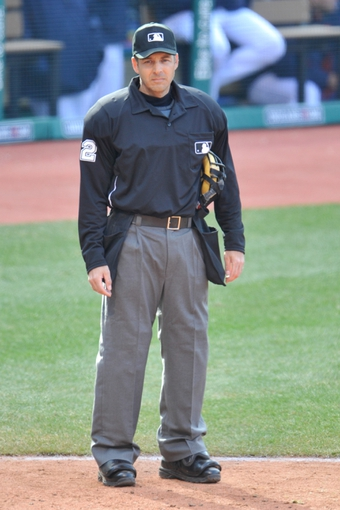 Apr 9, 2014; Cleveland, OH, USA; Home plate umpire James Hoye (92) reacts in game two between the Cleveland Indians and the San Diego Padres at Progressive Field. San Diego won 2-1. Mandatory Credit: David Richard-USA TODAY Sports