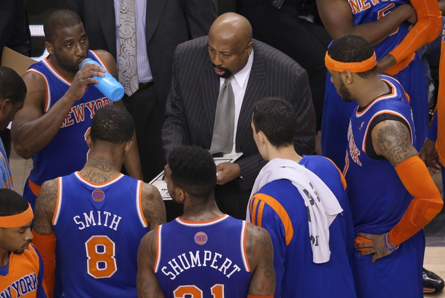 Apr 11, 2014; Toronto, Ontario, CAN; New York Knicks head coach Mike Woodson talks to his players during a timeout against the Toronto Raptors at Air Canada Centre. The Knicks beat the Raptors 108-100. Mandatory Credit: Tom Szczerbowski-USA TODAY Sports
