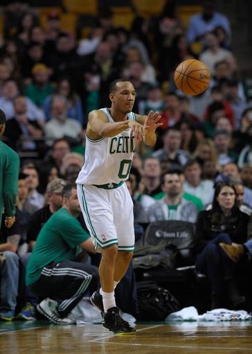 Apr 16, 2014; Boston, MA, USA; Boston Celtics guard Avery Bradley (0) passes the ball during the second half against the Washington Wizards at TD Garden. Mandatory Credit: Bob DeChiara-USA TODAY Sports