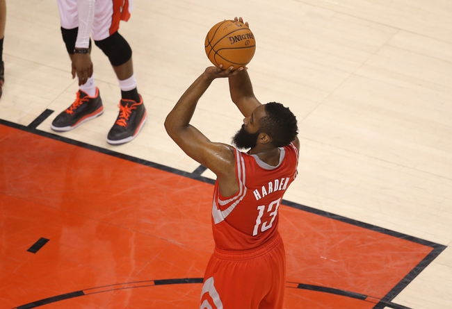 Apr 2, 2014; Toronto, Ontario, CAN; Houston Rockets guard James Harden (13) shoots a free throw against the Toronto Raptors at Air Canada Centre. The Raptors beat the Rockets 107-103. Mandatory Credit: Tom Szczerbowski-USA TODAY Sports