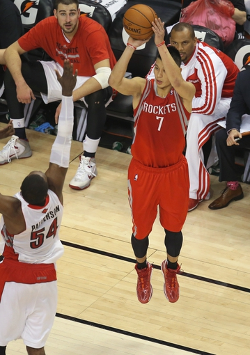Apr 2, 2014; Toronto, Ontario, CAN; Houston Rockets guard Jeremy Lin (7) hits a three-pointer against the Toronto Raptors at Air Canada Centre. The Raptors beat the Rockets 107-103. Mandatory Credit: Tom Szczerbowski-USA TODAY Sports