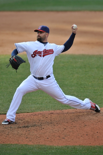Apr 9, 2014; Cleveland, OH, USA; Cleveland Indians relief pitcher Marc Rzepczynski (35) delivers against the San Diego Padres in game two at Progressive Field. San Diego won 2-1. Mandatory Credit: David Richard-USA TODAY Sports
