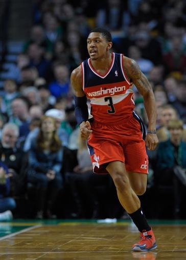 Apr 16, 2014; Boston, MA, USA; Washington Wizards guard Bradley Beal (3) runs up the court during the first half against the Boston Celtics at TD Garden. Mandatory Credit: Bob DeChiara-USA TODAY Sports