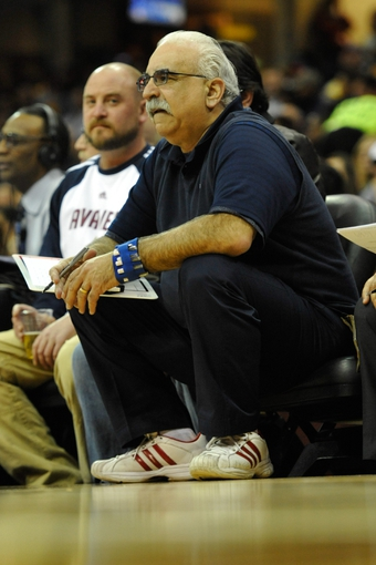 Apr 9, 2014; Cleveland, OH, USA; Detroit Pistons athletic trainer Mike Abdenour sits on the bench against the Cleveland Cavaliers at Quicken Loans Arena. Cleveland won 122-100. Mandatory Credit: David Richard-USA TODAY Sports