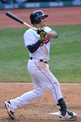 Apr 9, 2014; Cleveland, OH, USA; Cleveland Indians shortstop Asdrubal Cabrera (13) bats against the San Diego Padres in game two at Progressive Field. San Diego won 2-1. Mandatory Credit: David Richard-USA TODAY Sports