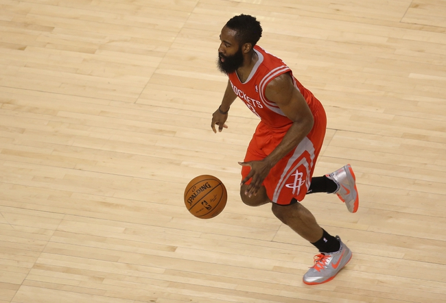 Apr 2, 2014; Toronto, Ontario, CAN; Houston Rockets guard James Harden (13) dribbles against the Toronto Raptors at Air Canada Centre. The Raptors beat the Rockets 107-103. Mandatory Credit: Tom Szczerbowski-USA TODAY Sports