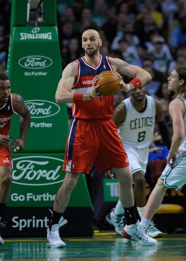 Apr 16, 2014; Boston, MA, USA; Washington Wizards center Marcin Gortat (4) looks to pass the ball during the second half against the Boston Celtics at TD Garden. Mandatory Credit: Bob DeChiara-USA TODAY Sports