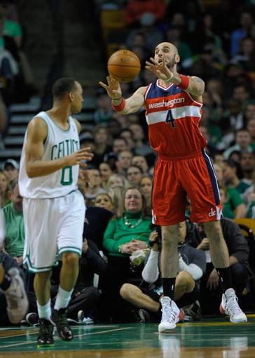 Apr 16, 2014; Boston, MA, USA; Washington Wizards center Marcin Gortat (4) passes the ball during the first half against the Boston Celtics at TD Garden. Mandatory Credit: Bob DeChiara-USA TODAY Sports