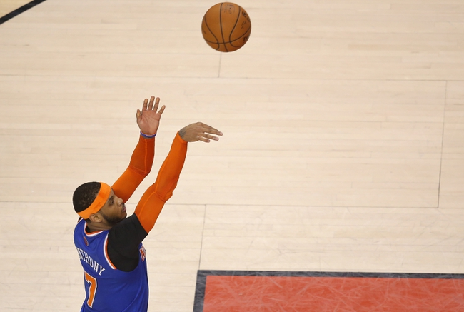 Apr 11, 2014; Toronto, Ontario, CAN; New York Knicks forward Carmelo Anthony (7) shoots a free throw against the Toronto Raptors at Air Canada Centre. The Knicks beat the Raptors 108-100. Mandatory Credit: Tom Szczerbowski-USA TODAY Sports