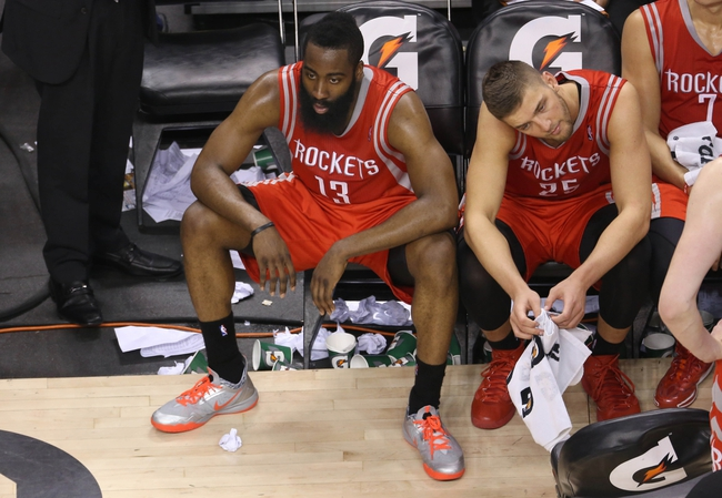 Apr 2, 2014; Toronto, Ontario, CAN; Houston Rockets guard James Harden (13) looks on from the bench next to forward Chandler Parsons (25) against the Toronto Raptors at Air Canada Centre. The Raptors beat the Rockets 107-103. Mandatory Credit: Tom Szczerbowski-USA TODAY Sports