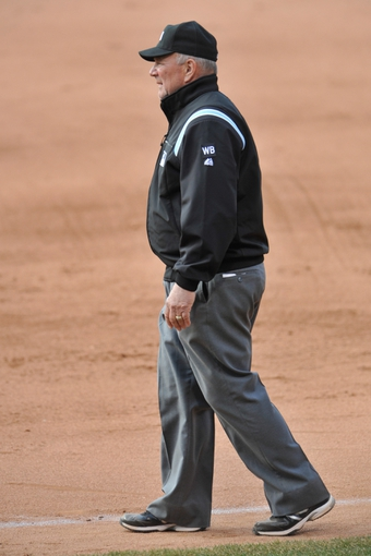 Apr 9, 2014; Cleveland, OH, USA; First base umpire Bob Davidson (61) reacts in game two between the Cleveland Indians and the San Diego Padres at Progressive Field. San Diego won 2-1. Mandatory Credit: David Richard-USA TODAY Sports