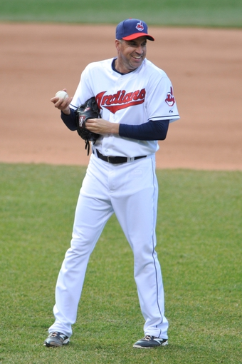 Apr 9, 2014; Cleveland, OH, USA; Cleveland Indians relief pitcher Scott Atchison (48) reacts against the San Diego Padres in game two at Progressive Field. San Diego won 2-1. Mandatory Credit: David Richard-USA TODAY Sports