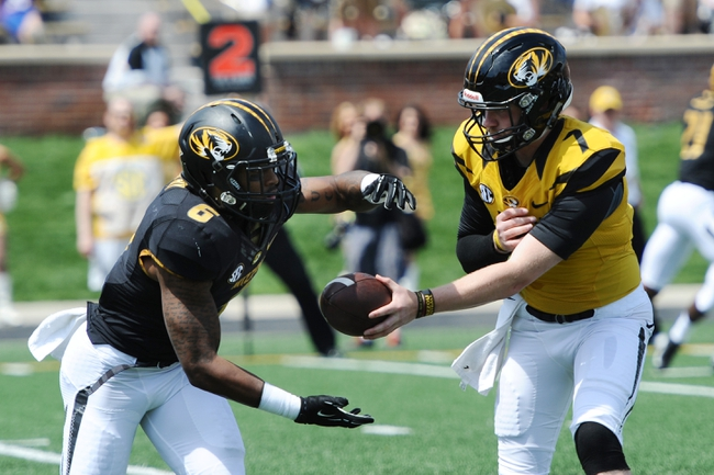 Apr 19, 2014; Columbia, MO, USA; Missouri Tigers quarterback Maty Mauk (7) hands off the ball to running back Marcus Murphy (6) during the Black & Gold Game at Faurot Field. Mandatory Credit: Dak Dillon-USA TODAY Sports