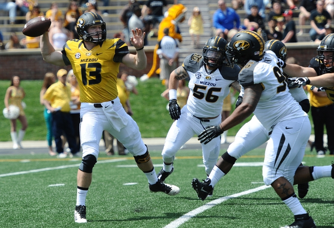 Apr 19, 2014; Columbia, MO, USA; Missouri Tigers quarterback Corbin Berkstresser (13) passes the ball over as Missouri Tigers defensive lineman Lucas Vincent (96) closes in during the Black & Gold Game at Faurot Field. Mandatory Credit: Dak Dillon-USA TODAY Sports